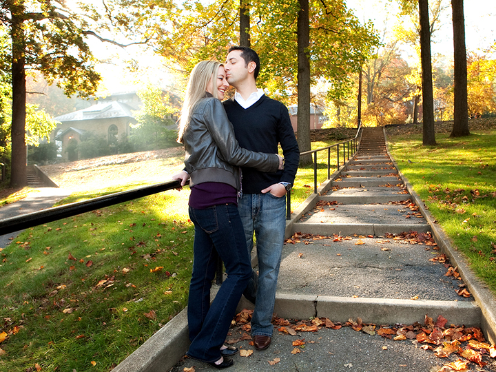 Loving couple standing on a path in fall holding one another