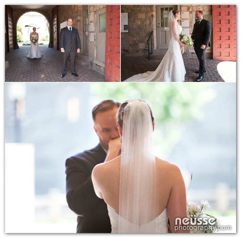 The First Look moments when bride and groom sees each other privately before ceremony on their first day of marriage under the arch of James A Michener Art Museum in Bucks County Pennsylvania USA