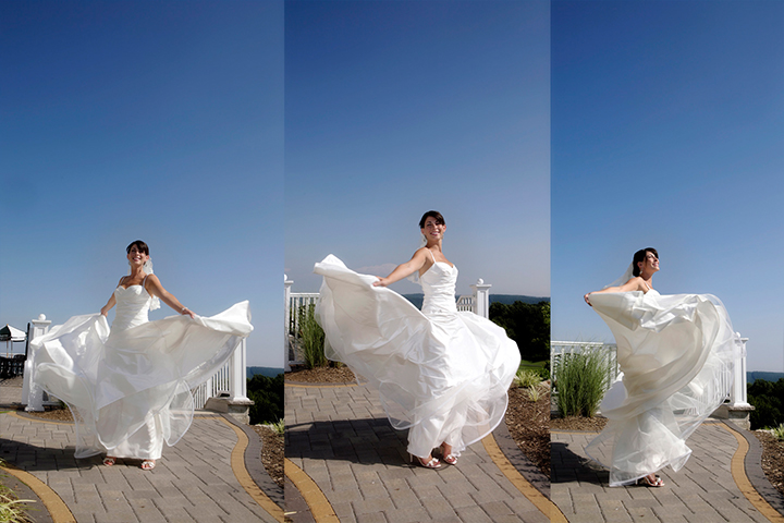 Bride spins in her beautiful wedding dress outside by the mountains.