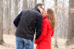 A stolen kiss between fiancee and fiance on a wintery day for an engagement session.