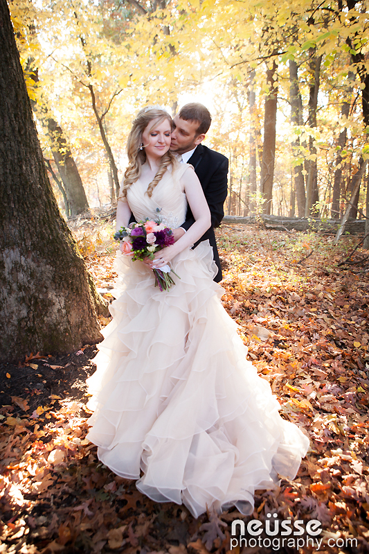 wedding day picture of bride and groom glowing in beautiful autumn sunshine and surrounded in colorful Fall foliage and trees at Stokesay Castle in Berks County Reading PA
